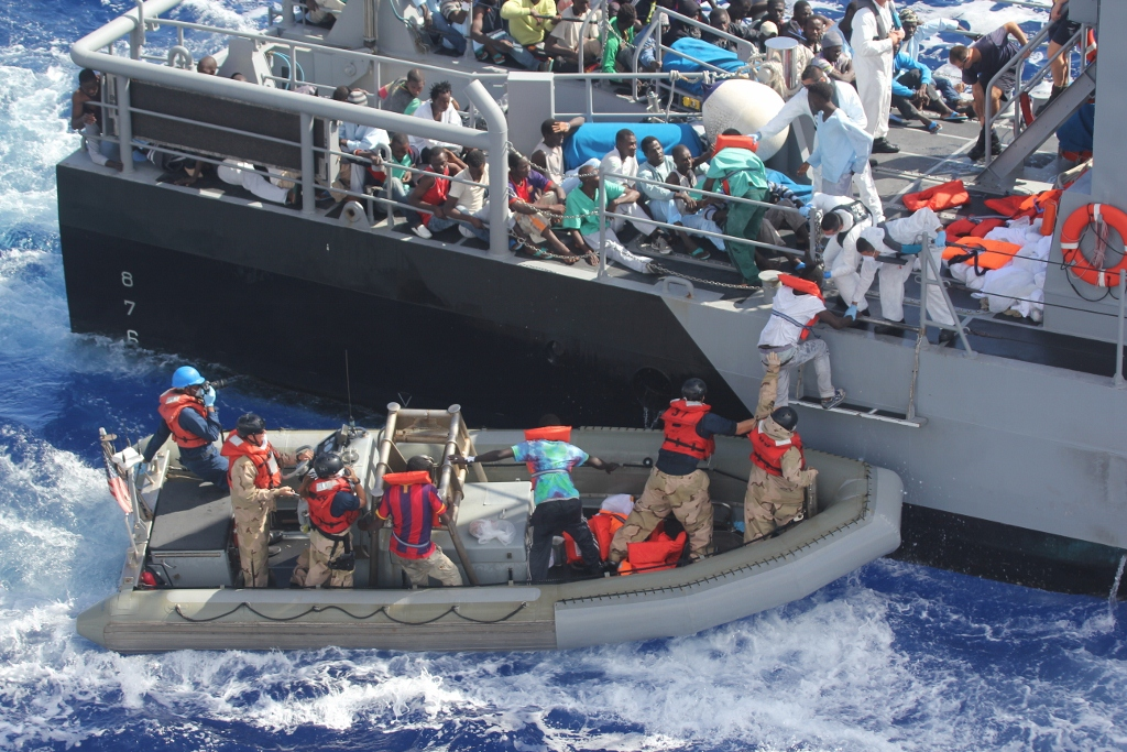 Migrant overboard!